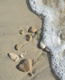 Stones on sand and motion blurry wave Stock Photography