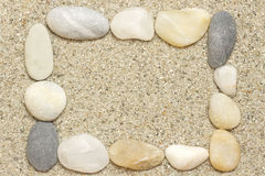 Stones on sand Stock Photos