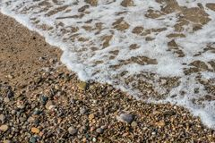 Stones on the sand. The stone in the sand which is located on the beach near the sea Royalty Free Stock Photography