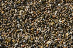 Stones on the sand. The stone in the sand which is located on the beach near the sea Stock Photo