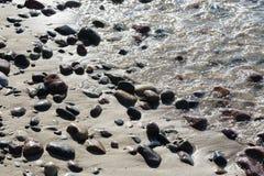 Stones on a sandy beach in Kolobrzeg Stock Photos
