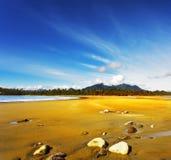 Stones on sandy beach ocean in  Canada Stock Images