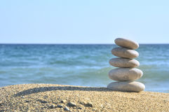 Stones on the sea. Stones balances on the beach of blue sea royalty free stock images