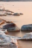 Stones in sea Stock Photos