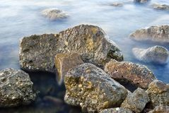 Stones in a sea Stock Images