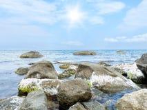 Stones into the sea Royalty Free Stock Photos
