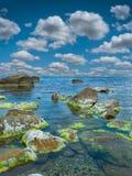 Stones into the sea Stock Image