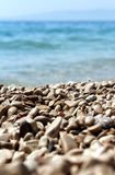 Stones by the sea. Stones by the blue sea Royalty Free Stock Photo