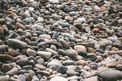 Pebbles on the beach. Stones on the sea beach Royalty Free Stock Image