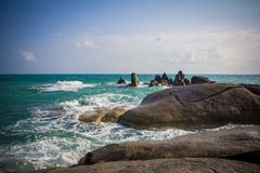 Stones in a sea and blue sky Stock Photo