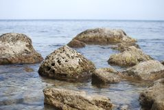 Stones in a sea, blurred water Stock Photography