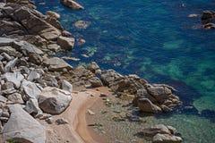 Stones on sea coast. Stones and sand on sea coast royalty free stock photo