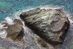 Stones in sea, high angle view Stock Photos
