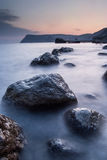 Stones in the sea on a long exposure Royalty Free Stock Photo