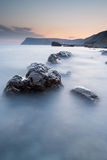 Stones in the sea on a long exposure Stock Photos