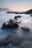 Stones in the sea on a long exposure Royalty Free Stock Images