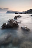 Stones in the sea on a long exposure Royalty Free Stock Photography