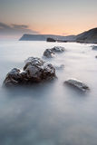 Stones in the sea on a long exposure Royalty Free Stock Photos