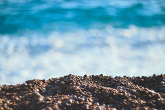 Stones and sea. Pebble Beach on a sunny day. Shallow depth of field Royalty Free Stock Photography