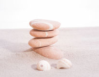 Stones and sea shell on sand Royalty Free Stock Image