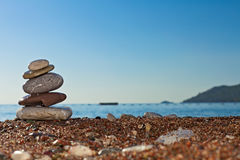 Stones on the sea-shore. Stack of stones on the Aegean sea-shore stock photography