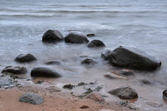 Stones in the sea. Two stones in the sea Stock Photography