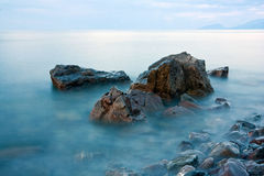 Stones in sea water Royalty Free Stock Image
