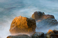 Stones in sea water Royalty Free Stock Images