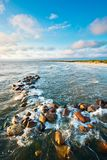 Stones in sea water Royalty Free Stock Photos