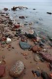 Stones in sea water autumn Stock Photo
