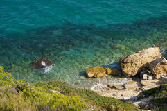 Stones in Sea Water. Rocks and stones in the sea water, among the towns Salou and La Pineda in the province of Tarragona (Spain Royalty Free Stock Photos