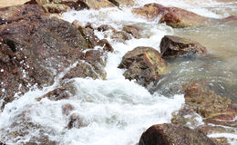 Stones in sea,water splashes on the stones.  Royalty Free Stock Photos