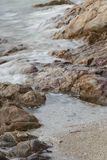 Stones by the sea. waves of the sea from long exposure Royalty Free Stock Photo