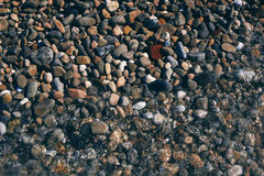 Stones on the seashore. Background Stock Images