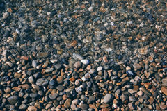 Stones on the seashore. Background Royalty Free Stock Photo
