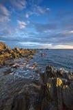 Stones seashore lit sun. Stock Image