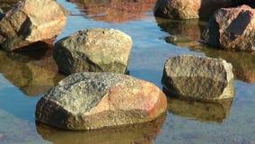 Stones at seaside stock video