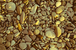 Stones. A sepia picture of beach stones in summer Royalty Free Stock Images