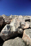 Stones and sky. Rocks on a blue sky background. Vertical composition Royalty Free Stock Photos
