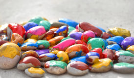 Stones with a smooth surface painted colorful paint Royalty Free Stock Photo