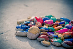 Stones with a smooth surface painted colorful paint Stock Photo