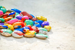Stones with a smooth surface painted colorful paint Stock Photos