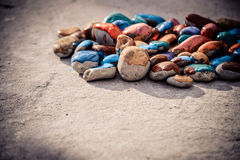 Stones with a smooth surface painted colorful paint Royalty Free Stock Photography