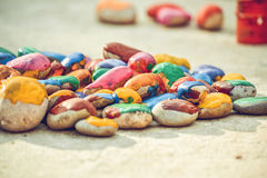 Stones with a smooth surface painted colorful paint. Abstract creative background close-up. Stones with a smooth surface painted with colorful paint royalty free stock image