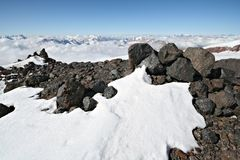 Stones in snow against clear blue sky near Elbrus Royalty Free Stock Photos