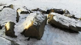 Stones in the snow in winter Royalty Free Stock Photography