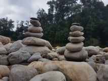 Stones. Some stones stablihed in columns, in front of a river in Asturias royalty free stock photos