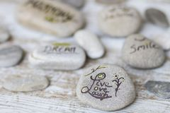 Welness concepts on stones. Stones with some words writen on them royalty free stock photos
