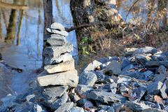 The stones. Someone piled the stone near the river Royalty Free Stock Photo