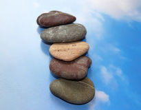 Stones for spa procedures of the blue sky. Royalty Free Stock Images